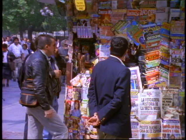 CHILE, 1998, Santiago, newsstand kiosk with magazines and people buying