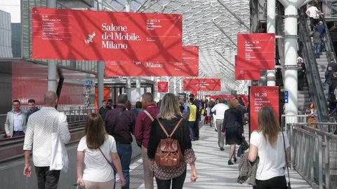 Milan, italy - april 17 , 2018: visitors walk in the pathway at the salone  internazionale del mobile - furniture trade fair in rho-fiera milano, the  largest trade fair in the world of this kind