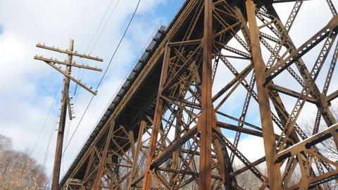 Rusty steel trestle train bridge and telephone pole. Toronto, Canada.