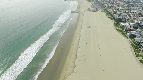 Beautiful aerial over beach and neighborhood in California