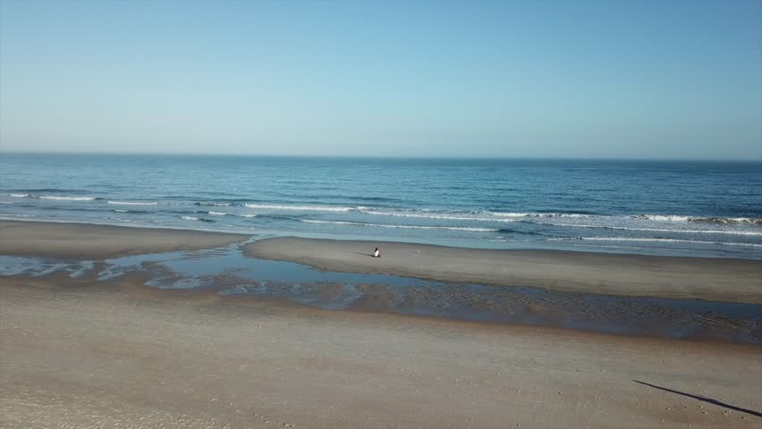 Woman sitting alone on the South Carolina coast on Pawley's Island