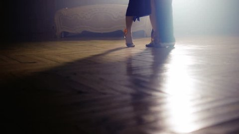 silhouette of a couple in the fog of dancing tango