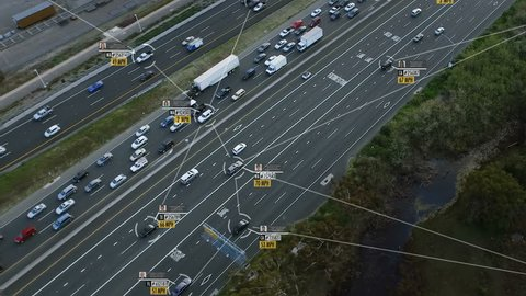 Traffic surveillance system in highway. Connected network. Speed and identity Control System. Blurred and fake driver and car information displaying. Future transportation. Internet of things.