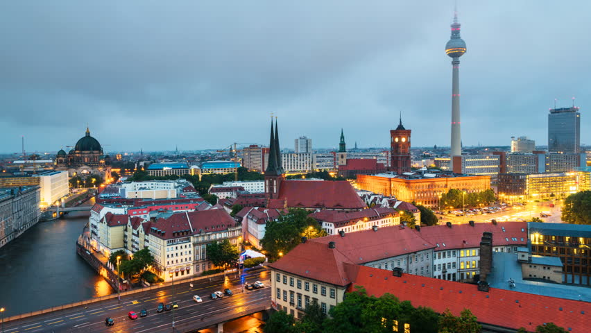 Berlin, Germany. Illuminated landmarks in Berlin, Germany in the morning. Time-lapse of colorful cloudy sky at sunrise during the rain