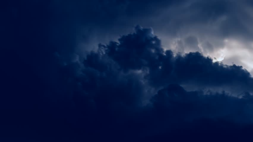 Timelapse of Clouds and Stormy Night. 3840x2160. Time lapse hurricane storm, intense rotating supercell thunderstorm, with impressive lightning strikes. UHD.