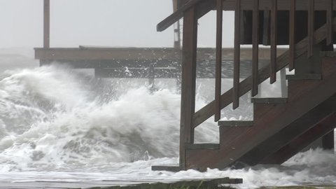 Rockport, TX/US - August 26, 2017 [Major Hurricane Harvey making landfall in Rockport, Texas. Hurricane winds, storm surge flooding along the coastal homes. Waves crashing into houses.]