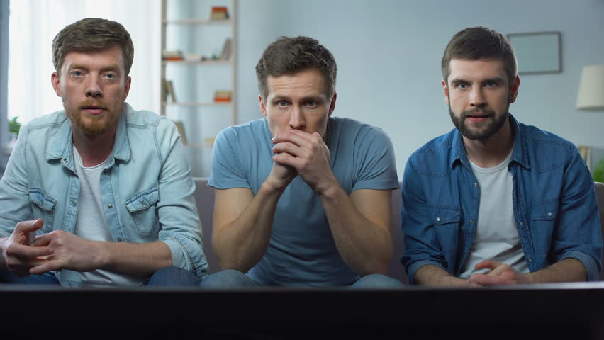 Three best friends watching sport competition on tv at home, enjoying good game | Shutterstock HD Video #1010379116
