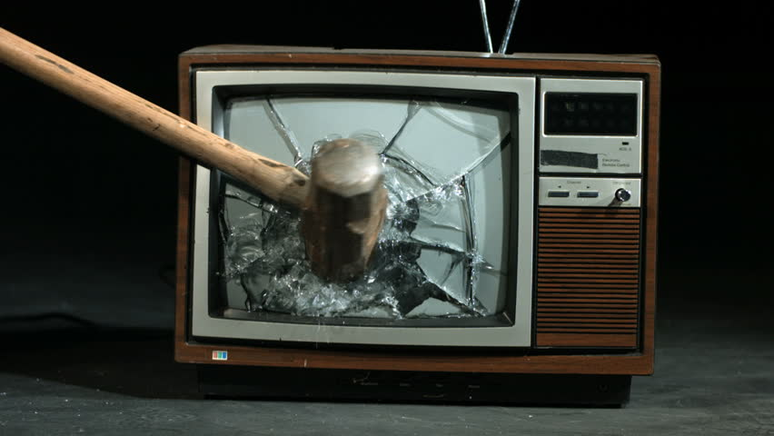 Slow motion smashing tv screen with sledgehammer