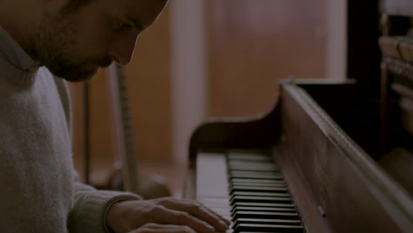 Close up of pianist playing piano HD stock video. Alexa camera