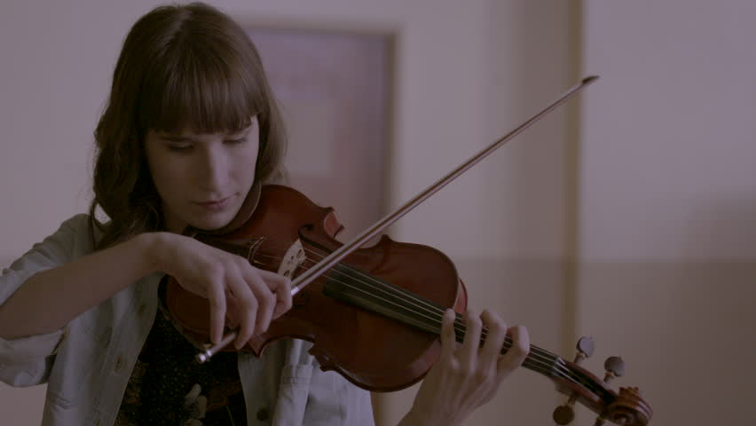 Female musician playing her violin HD stock video. Alexa camera