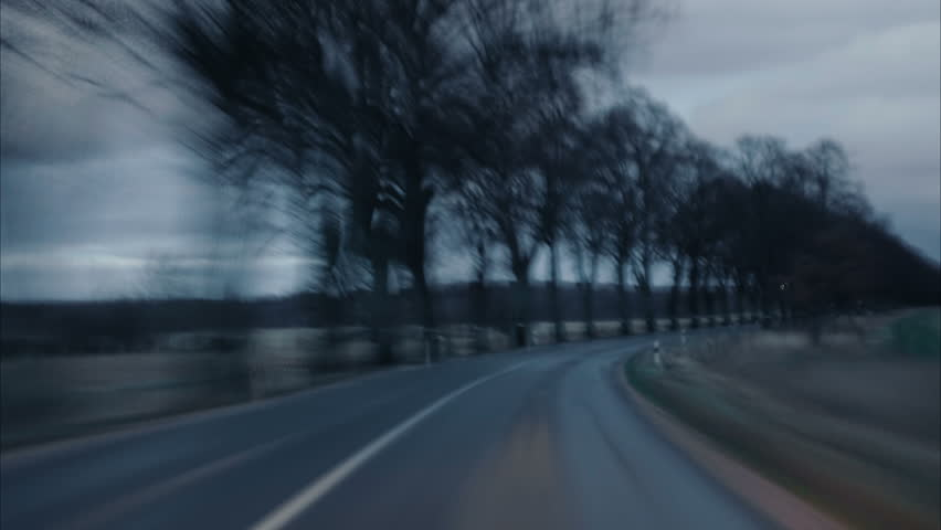 4K Driving POV Hyperlapse at sunset. Video footage of driving on a country road in the black forest time lapse. UHD Timelapse.