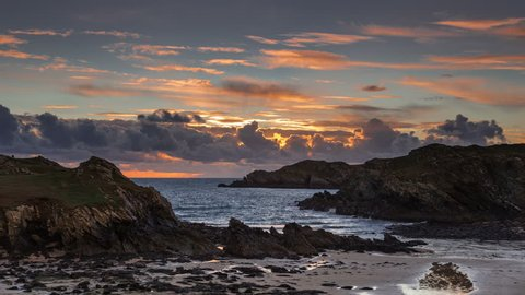 4k time lapse of clouds at sunset over the Irish Sea at Porth Dafarch on the coast of Anglesey, North Wales