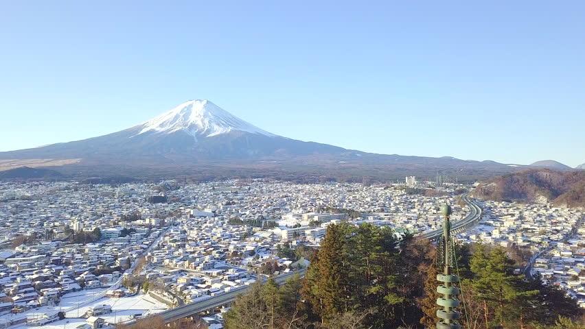 Temple of the Red Chedi or Chureito red Pagoda in beautiful winter and Mt. Fuji in Fujiyoshida, Japan