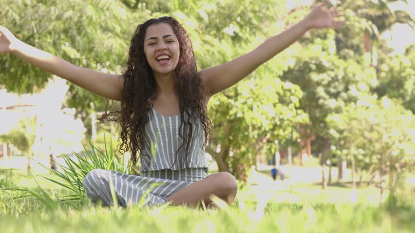 Fitness, woman training yoga pose outdoors in the park, copy space. Young slim girl makes exercise. Stretching, wellness, calmness, relax, healthy, active lifestyle concept | Shutterstock HD Video #1010611826