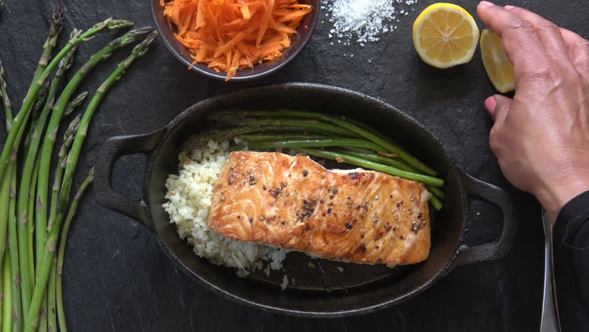 Grilled Salmon Fillet with Asparagus and Cauliflower Rice.
