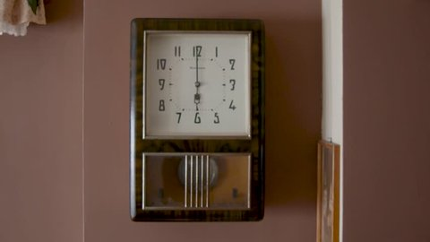 Old Soviet wall clock with a pendulum.