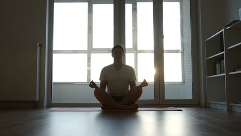Man are doing yoga exercises (lotus) in the morning