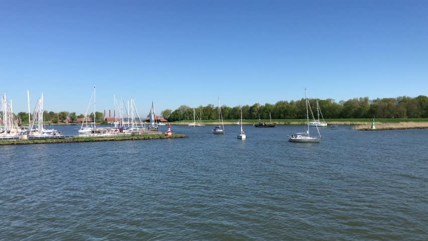 Pleasure boats sailing near the harbor of Enkhuizen, the Netherlands.