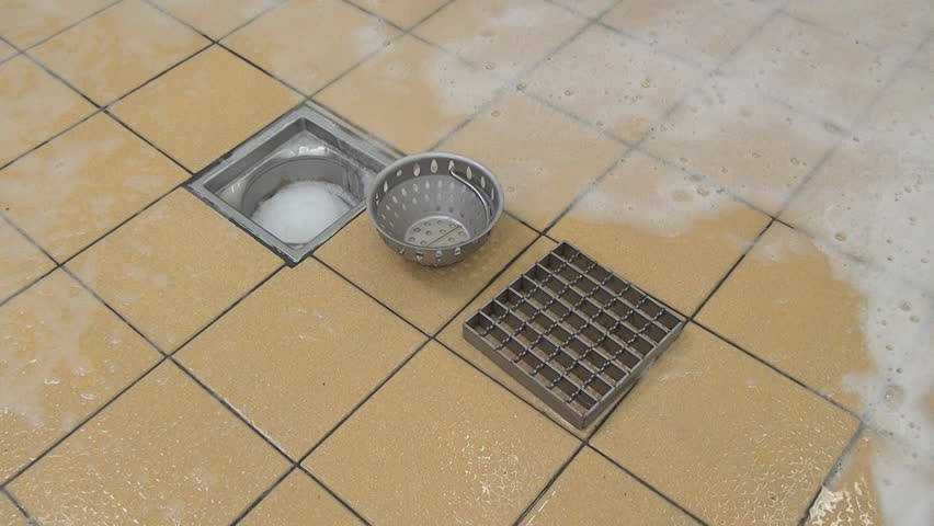 Cleaning drainage system from remnants of food and dirt. Application of disinfectant solution. Washing of premises and equipment in food industry, supermarkets, warehouses with food and other places. | Shutterstock HD Video #1010700806
