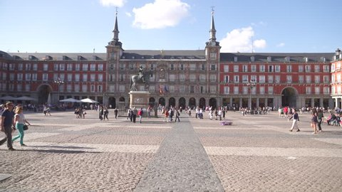 MADRID, SPAIN 27 APRIL 2018: Tourist visiting the famous Plaza Mayor /Main Square/in Madrid, Spain. Plaza Mayor in Madrid, a major tourist landmark in central Madrid