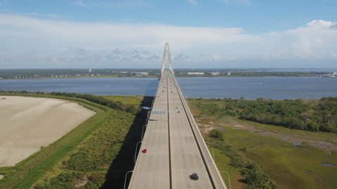 South Carolina Charleston Aerial v71 Flying backwards over Arthur Ravenel Jr bridge & Drum Island 10/17