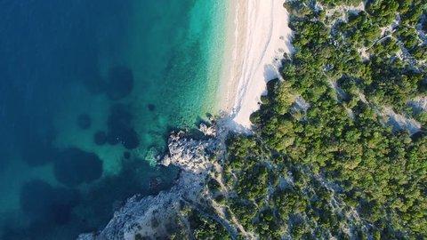 CRES, CROATIA: Aerial view of cliffs alongside popular tourist destination Lubenice beach. 4k drone video downward and forward.