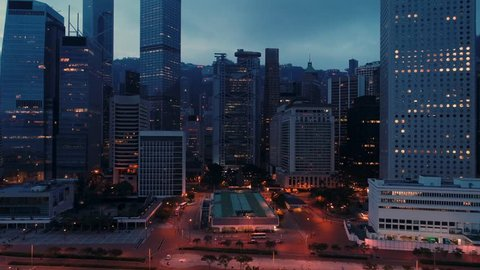 AERIAL. Night panoramic shot of Hong Kong city centre. Camera moving from down to top.
