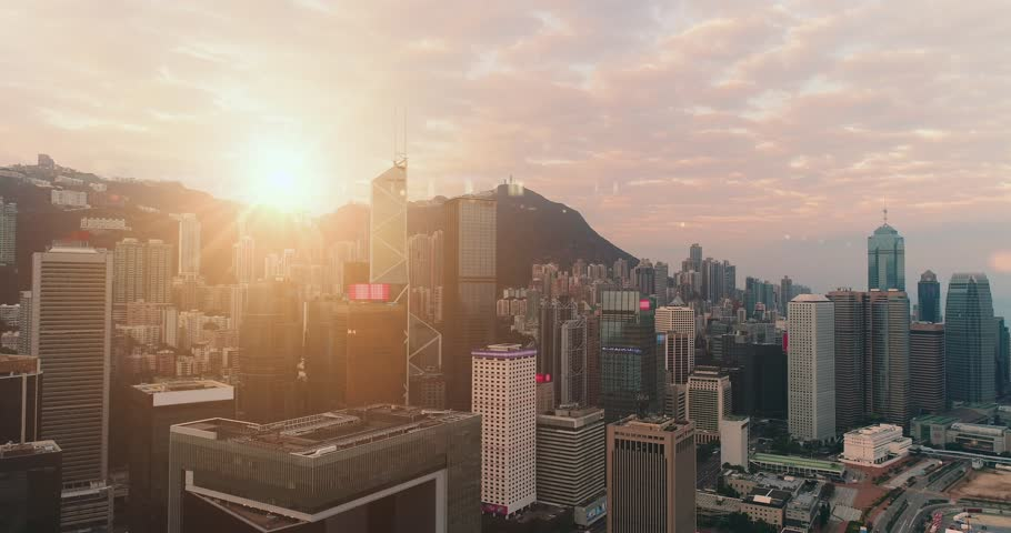 AERIAL. Fast flight between buildings at Hong Kong city centre. Sun light at background. | Shutterstock HD Video #1010823836