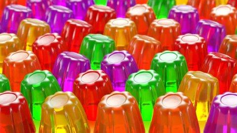 Jiggling multicolour jelly desserts.