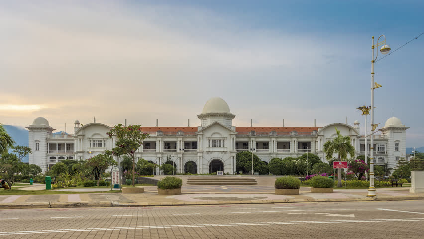 Ipoh, Perak, Malaysia - April 29, 2018: Footage 4k Time-lapse of a railway station at Ipoh sunset time with beautiful sky view sunset on cloudy two tone color.