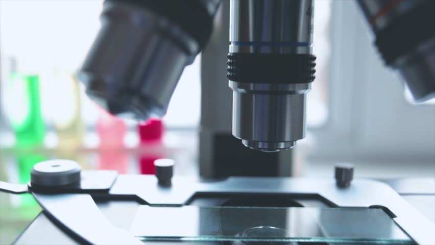 Optical microscope - science and laboratory equipment. Microscope is used for conducting planned, research experiments, educational demonstrations in medical and clinical laboratories. | Shutterstock HD Video #1010886176