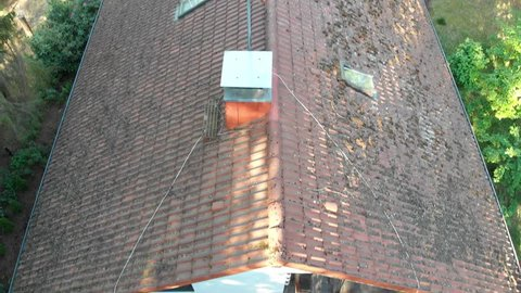 Inspection of the roof by overflight of a single-family house to check the condition of the roof tiles, aerial view