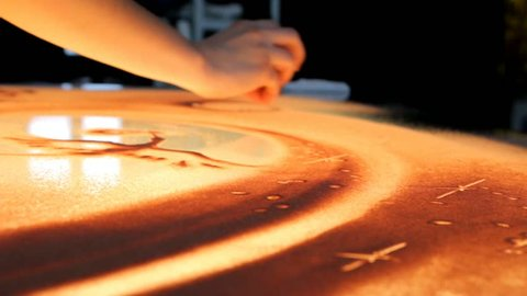 Drawing with sand. Drawing sand on a screen. Sand Artist. Hands draws. Animation