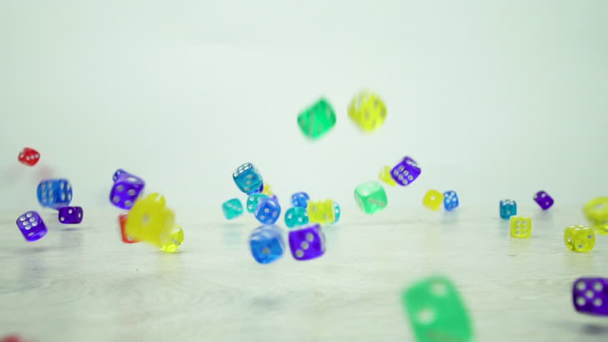 Slow motion shot of multicolored dice fall on a white background | Shutterstock HD Video #1010964956