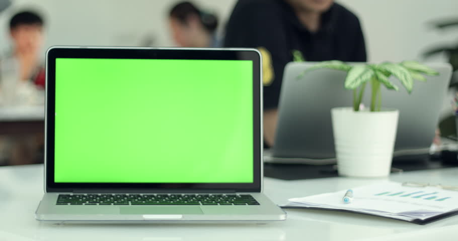 Green laptop computer screen set in front of workgroup | Shutterstock HD Video #1011012266