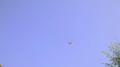 The plane is in the sky. Wat Ming Mueang ,Nan City Pillar Shrine ,Thailand