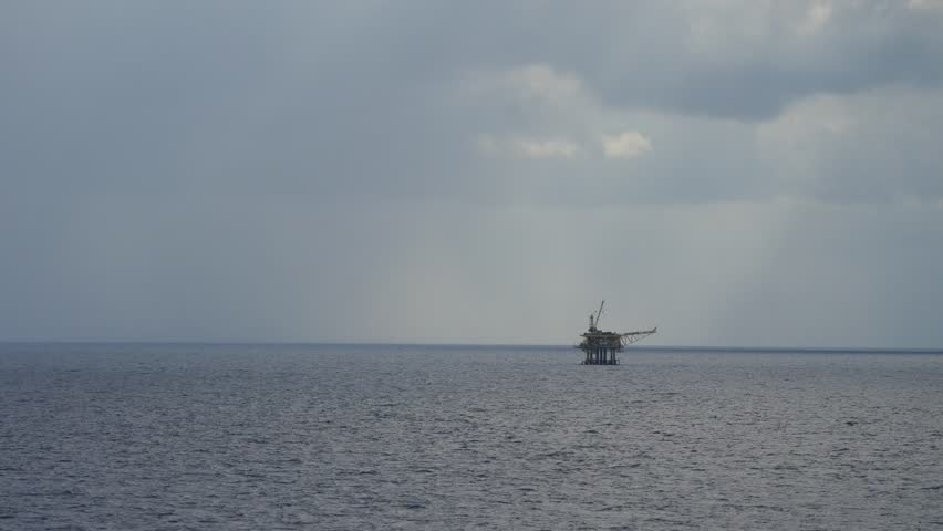 Small offshore platform and storm in the middle of the ocean