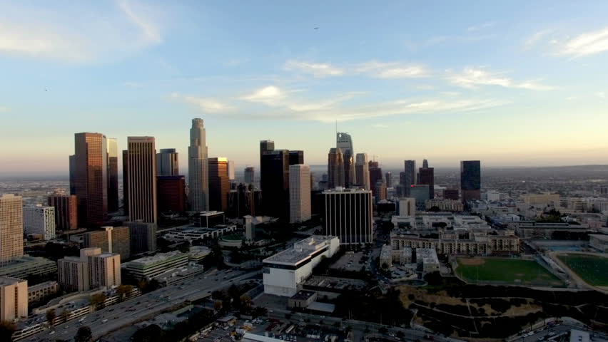 Drone shot of Los Angeles skyline below plane and helicopter | Shutterstock HD Video #1011072566