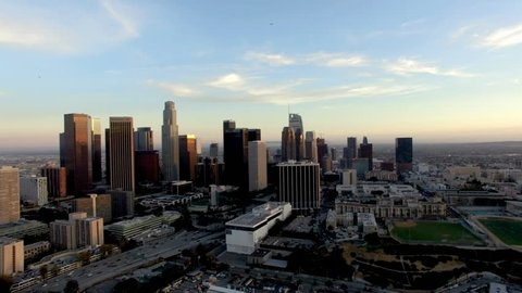 Drone shot of Los Angeles skyline below plane and helicopter