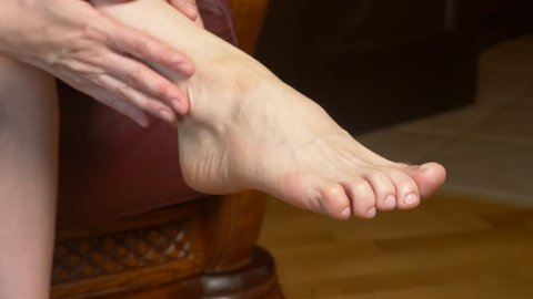 a woman with her own hands sensually and romantically caresses her legs. futfetish. 4k slow motion, close-up