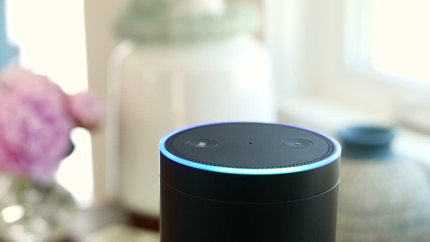 Amazon Alexa / Amazon Echo is on a table near Window.  Activates.