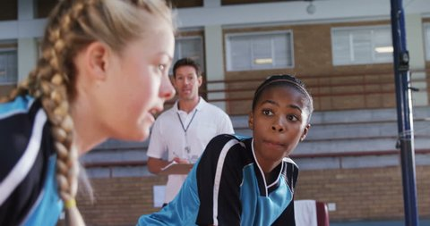 Female players interacting with each other while playing volleyball in the court 4k