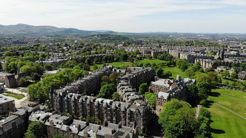 Aerial drone footage of suburban houses and fields in Edinburgh, Scotland, UK