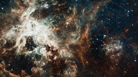 Space flight to Tarantula nebula, 3D animation with moving stars rotating stars field and light flares explosions. Contains public domain image by NASA