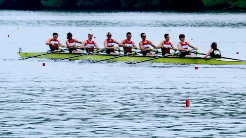 Philadelphia, PA / USA - 5/11/2018: Dad Vail Regatta, group of eight person oared rowing boat race over river