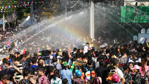 Bangkok, Thailand-April 14, 2018: Locals and tourists celebrate Songkran Festival, Traditional Thai New Year. People play water, and some use water guns to enjoy the festival.