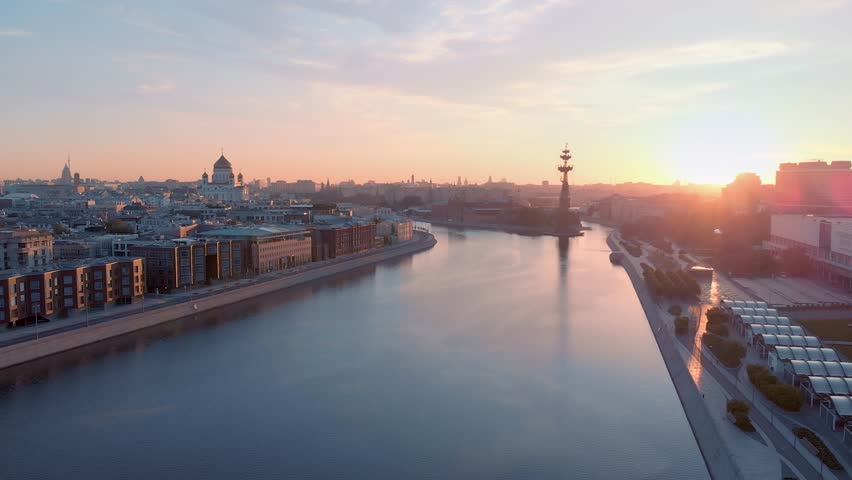 Sunrise aerial shot of famous Temple of Christ the Savior and the Monument to Peter the Great in Moscow against the background of the river.   Shutterstock HD Video #1011346016