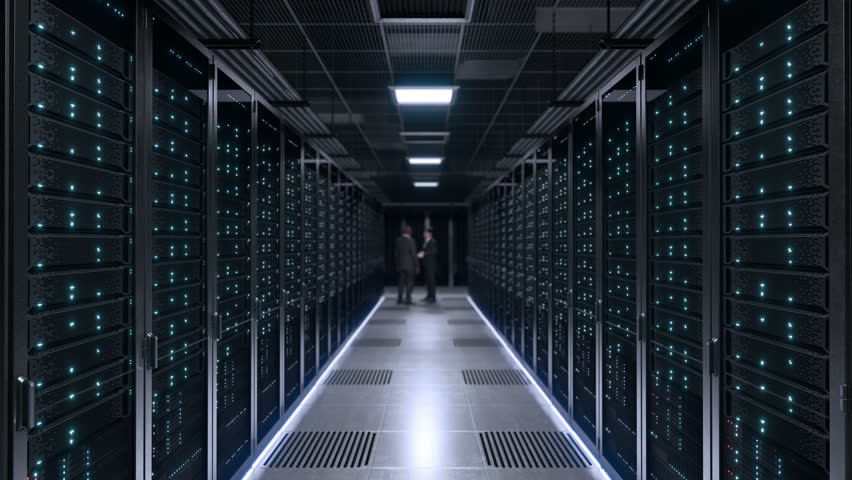 Data center two IT Engineers working | Shutterstock HD Video #1011347156