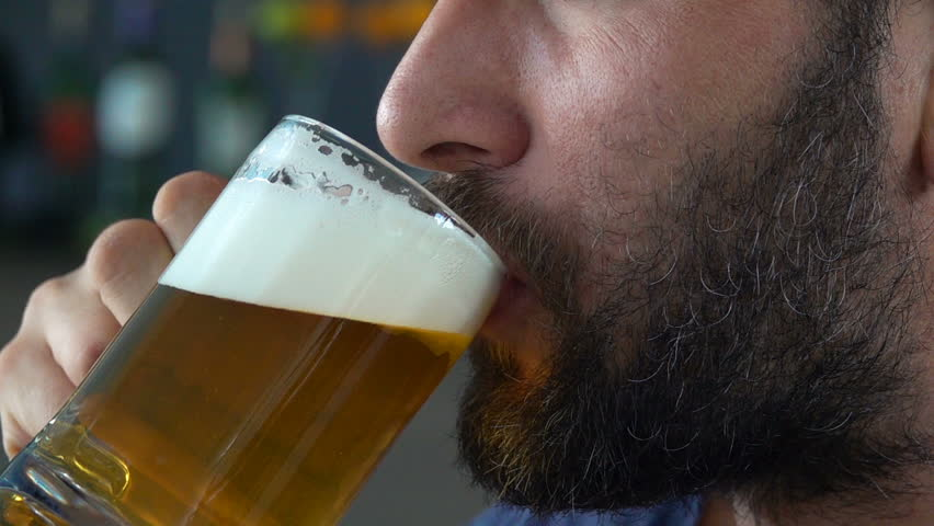 Close up of male face drinking beer in cafe, super slow motion 240fps  | Shutterstock HD Video #1011354176