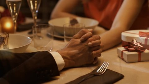 Couple having a romantic dinner date at the restaurant, the man is giving an engagement ring to the woman, St Valentines and marriage proposal concept, video montage